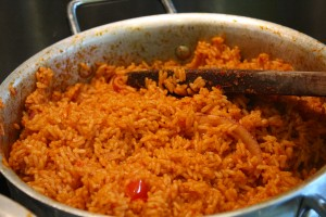 Stirring jollof rice