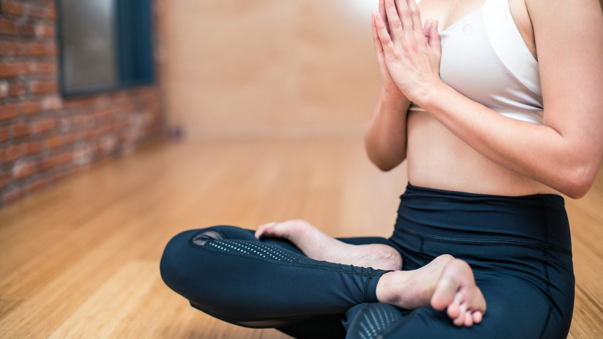 lady practicing yoga for mental fitness